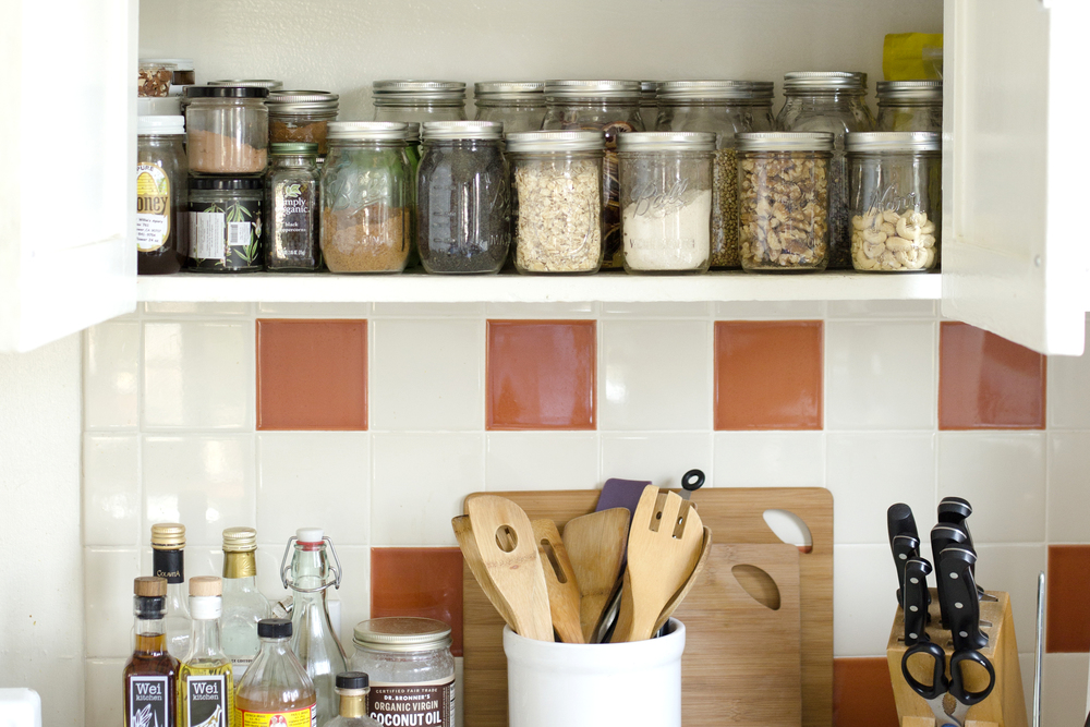 There's no packaging in her pantry. She fills reusable glass jars with foods from the bulk bins.   Photo by Matthew Romasanta