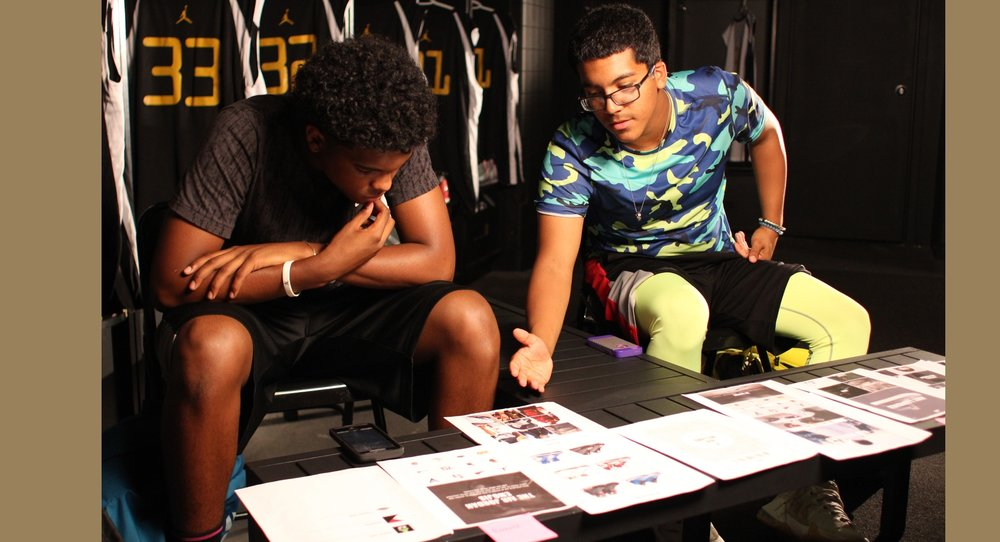 Here we're interviewing two promising young teen basketball players. They're reacting to paper prototypes we created which describe a potential Jordan app.