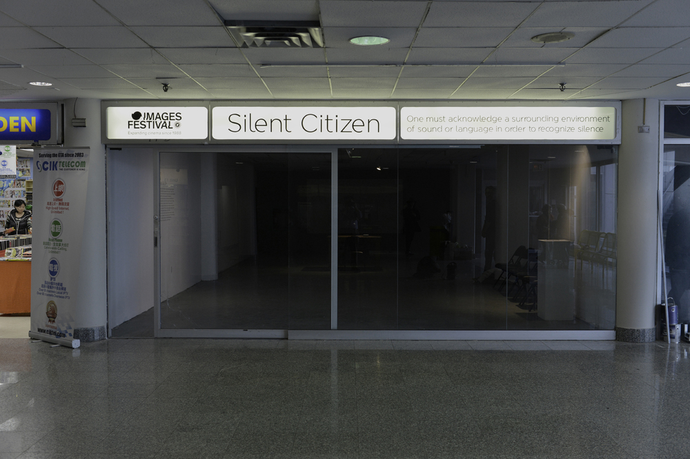 "As more people speak into the microphone, and a variety of different voices are archived, the sound of ""proper"" Canadian speech is rendered indiscernible. In this way  Silent Citizen  reveals the impossibility of the testing process to create a homogenized national subject, rather demonstrating its existence as an arbitrary remnant of a colonial fabric that still needs to be unraveled."