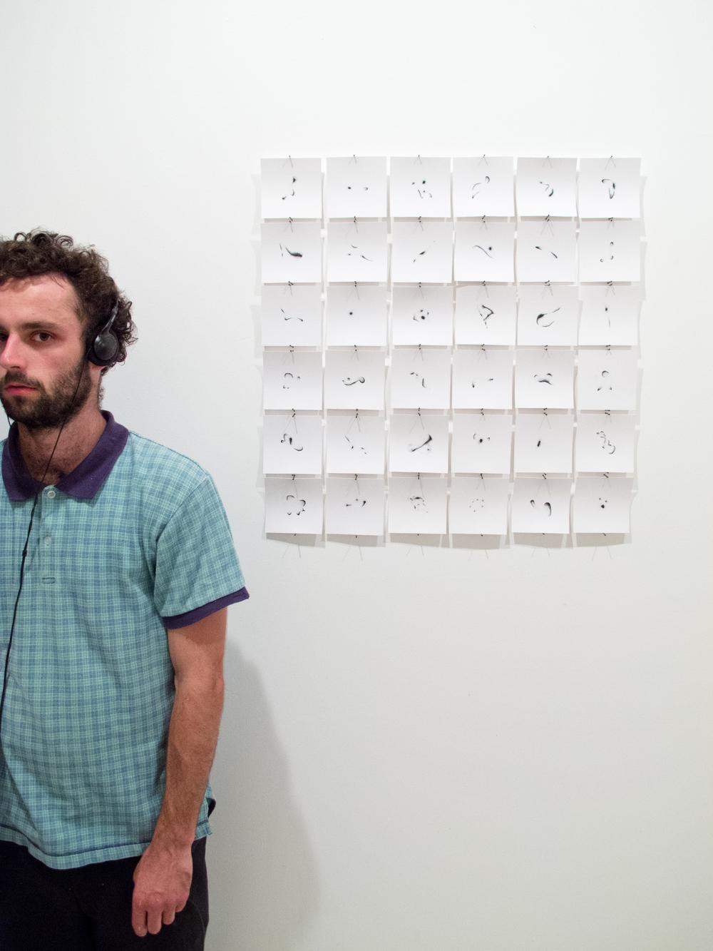 Artist Alex LeGolvan with His Work