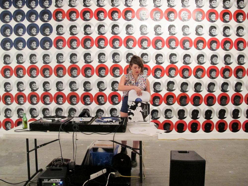 DJ Nina Tarr in Front of MJ Flag Installation