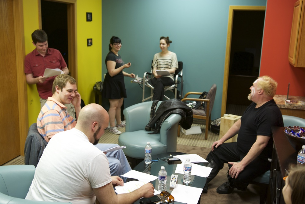 In the green room at our location,  rehearsing the script with our talented cast.