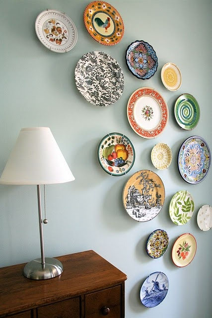 Great collection of plates hung in foyer.
