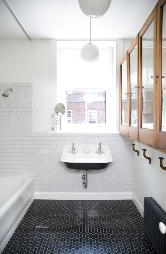 floor to ceiling subway tile bathroom. 3x6 subway tile with a small black hex floor is just so classic. great vintage inspired sink and upper cabinetry for storage. also, love the pendants. to ceiling bathroom