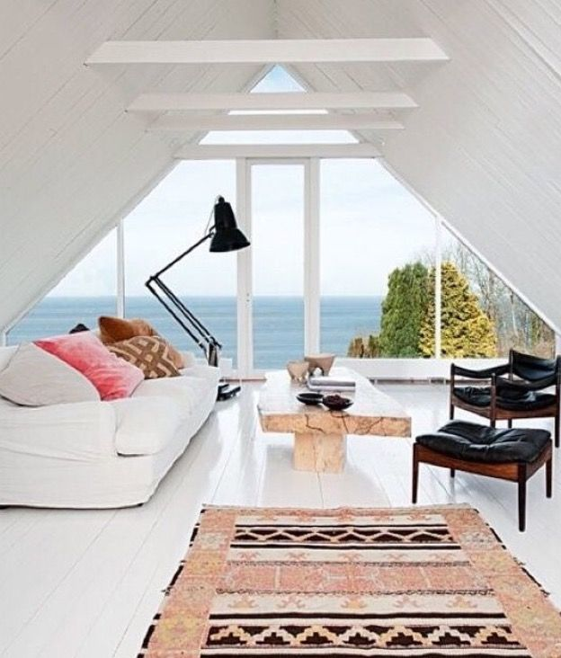 White floors, white walls, and the triangle window.