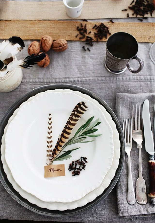 I have no idea where you find feathers this cool, but if you do, definitely pair them with a sprig of rosemary. And isn't this the most perfect shade of grey linen?