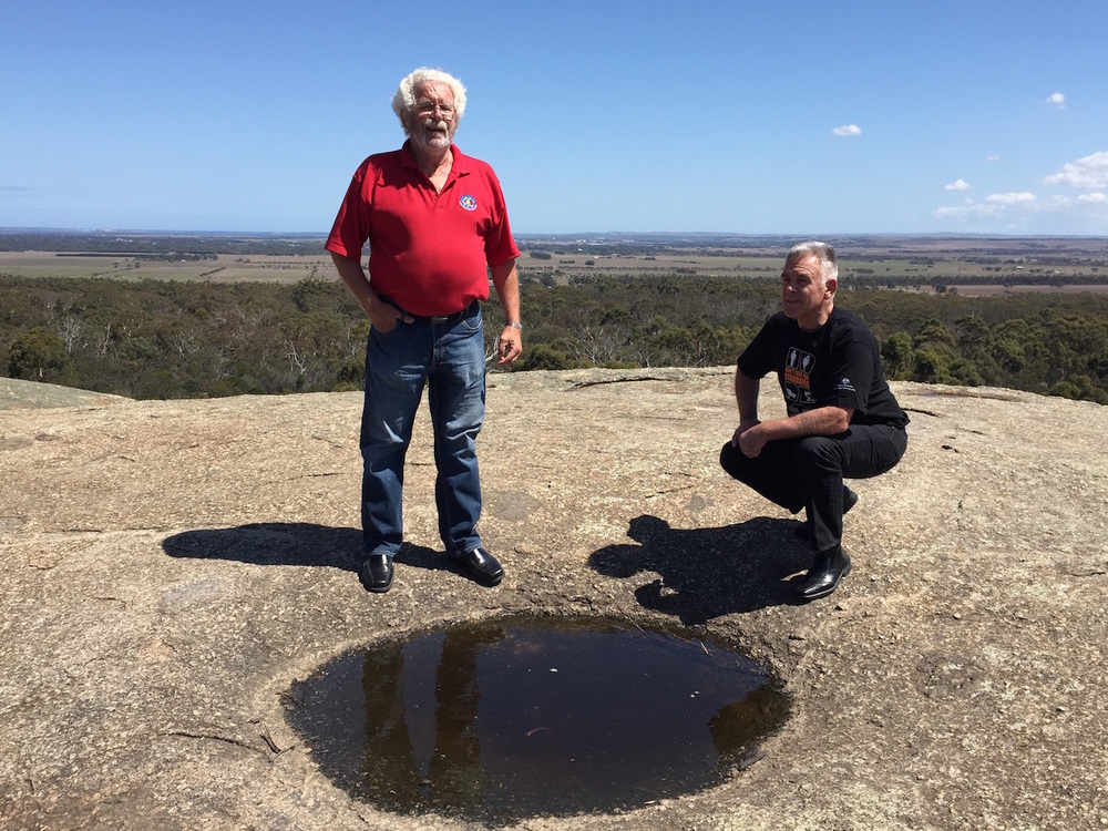 Uncle Bryon Powell and Gareth Powell talk ceremony at the rock well