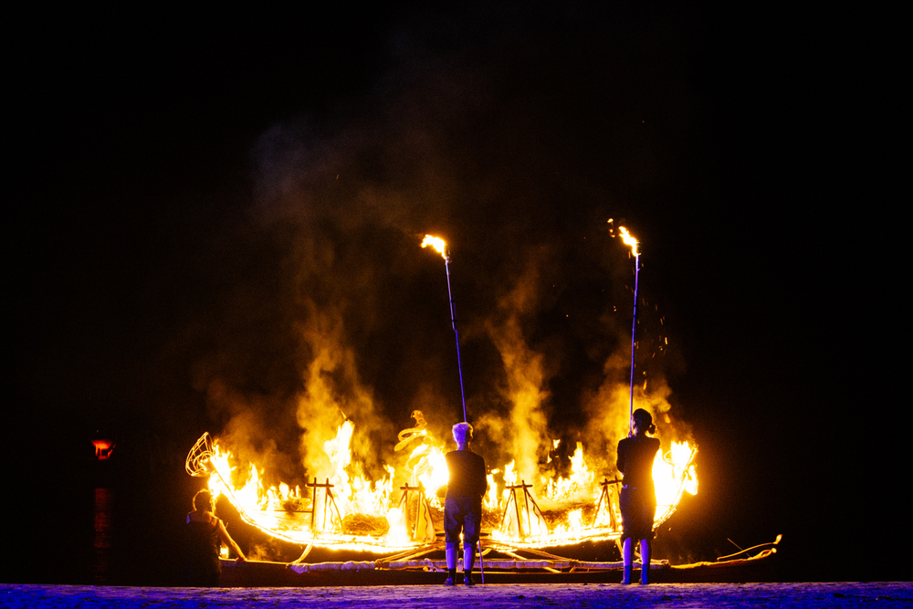 Canoe is set aflame. Image by Dean Walters Photography.