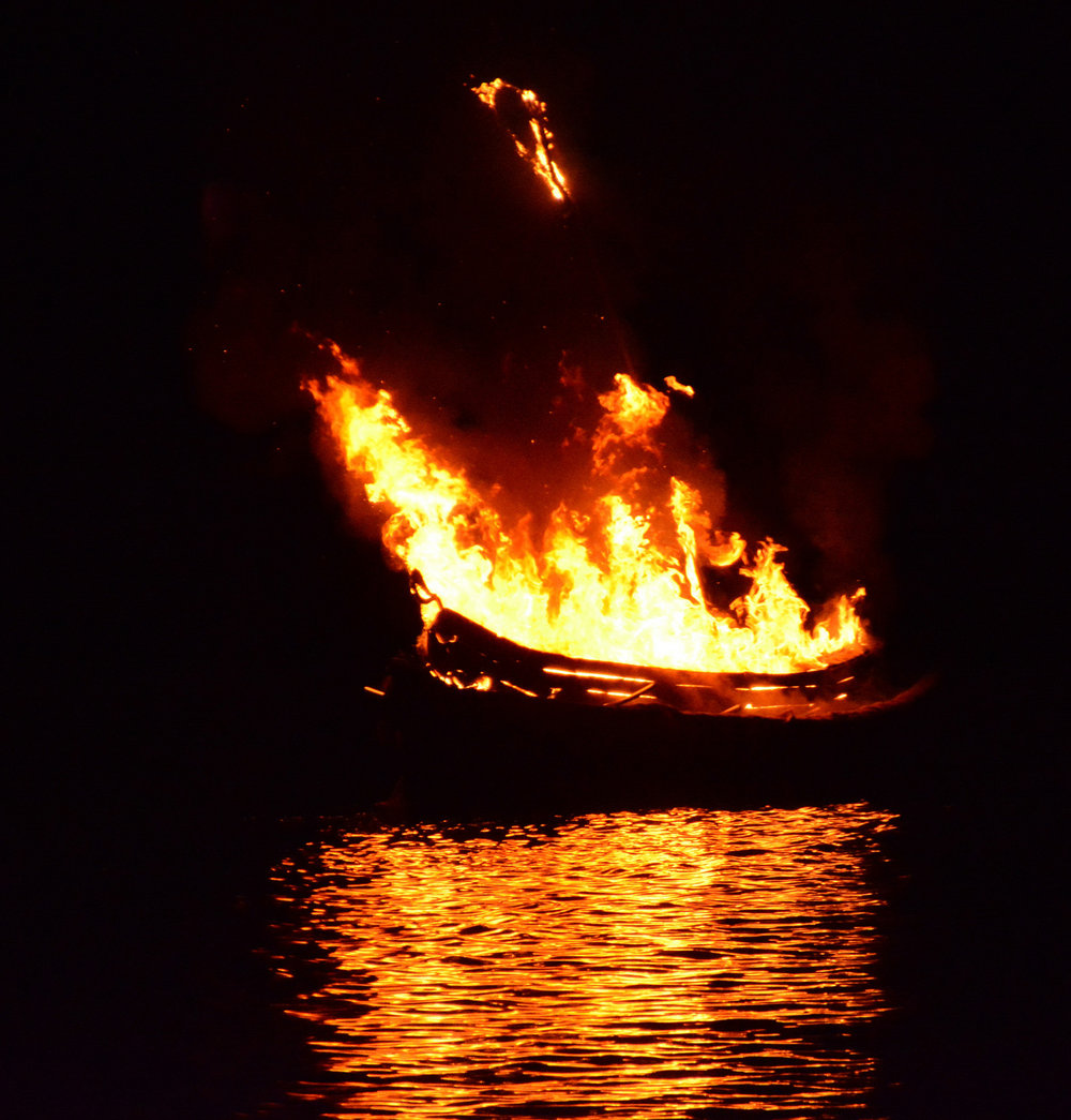 Photo by Gerry van der Meer of the burning canoe  at the final ceremony 2014