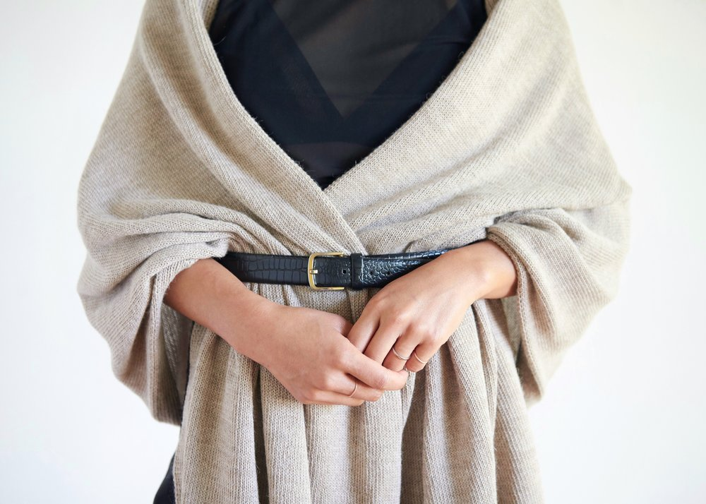 Look OneBelted. - Drape the wrap over your shoulders, place belt over the loose ends and close at waist. Adjust folds accordingly.