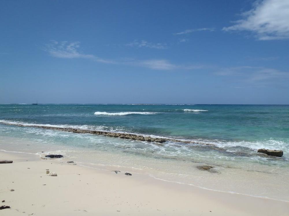 A long expanse of beach at Surfer's Beach, Grand Cayman.
