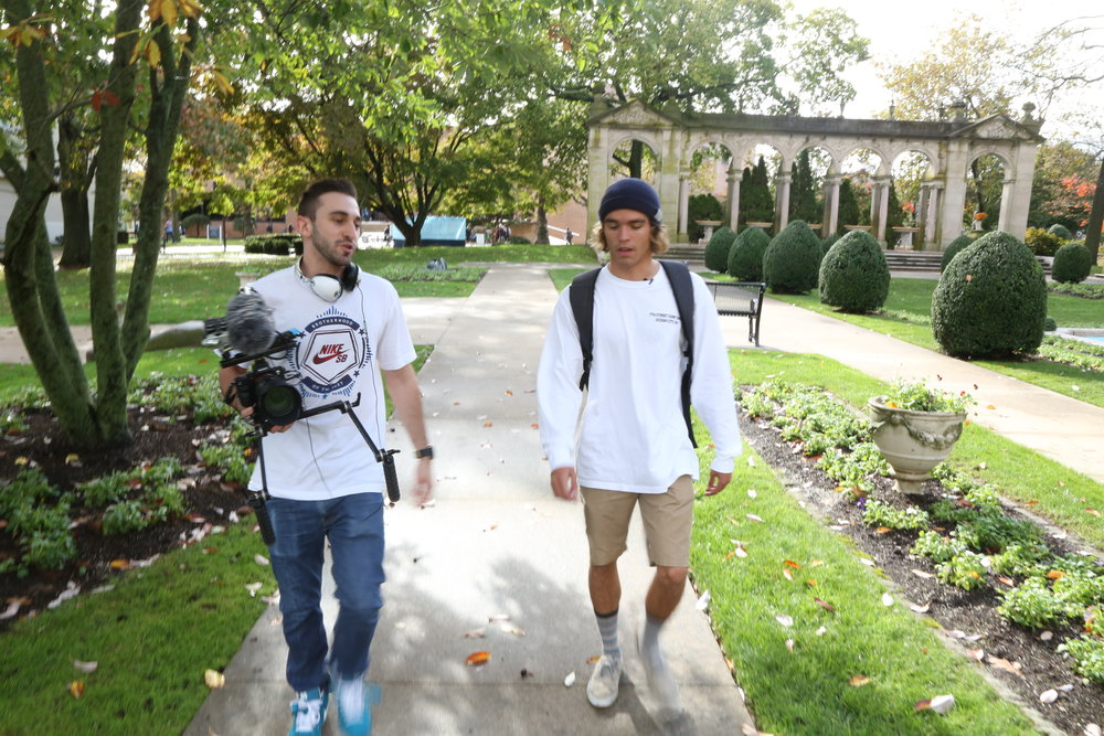 Director Christian DiPillo (left) walks Tyler (right) through campus.
