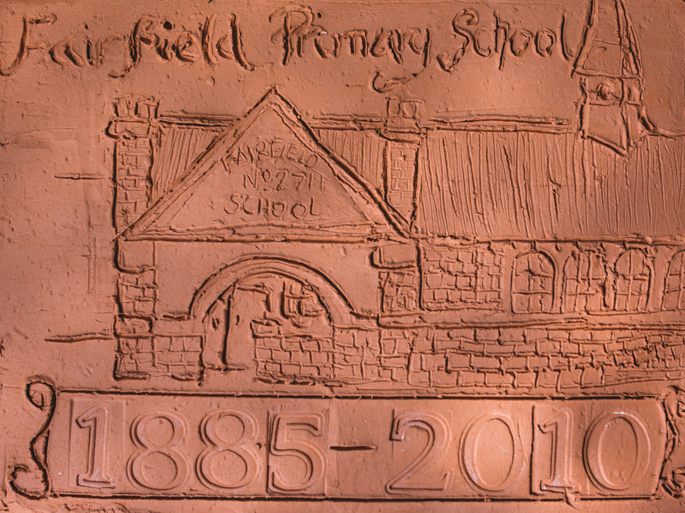 The students each made a tile in their art class to represent a different year in the school's history. These are fixed to a wall adjacent to the playground. I was thrilled to be given a 125th anniversary tile to keep as a moment of the project.