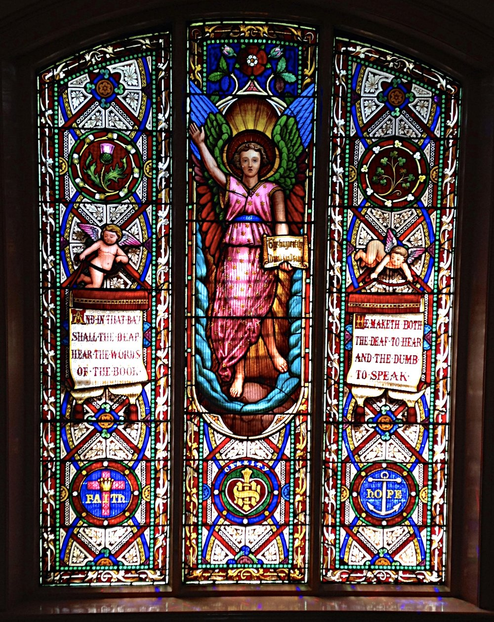 Institutional history - the beautiful Ferguson and Urie leadlight window installed in the stairwell of the former Victorian Deaf and Dumb Institution in 1866, today the Deaf Children Australia in St Kilda Road. Quoting from the Bible it pronounces 'And in that Day, shall the Deaf Hear the Word of the Book' and  'He maketh the Deaf to Hear and the Dumb to Speak'