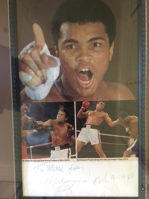 An autographed photo Ali gave to my son during his visit in Dakar.