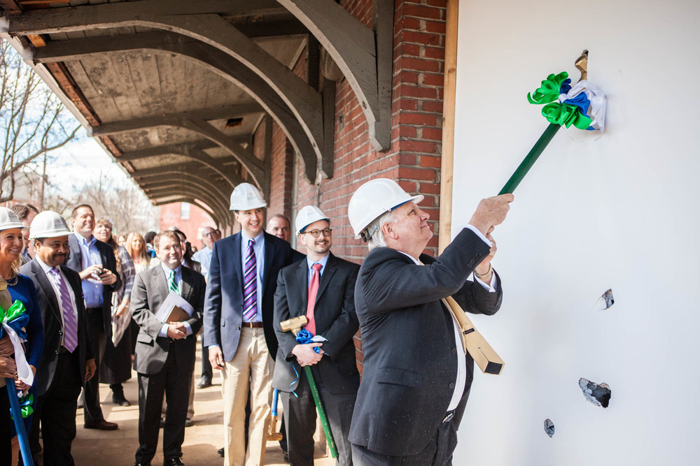 The Honorable Tim Hennessey, PA House of Representatives, commemorating the groundbreaking with a solid wall bashing.