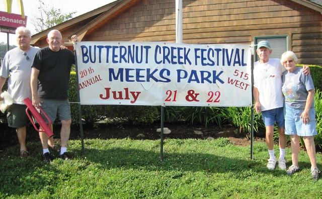 Putting up banners for 20th Annual Butternut Creek Festival. Duncan Sickler, Tom Chambers, Paul & Helena Grossmann.