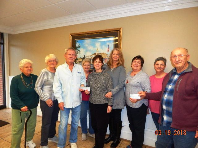 2018 Checks in support of the Art Programs at Union County Middles School and Woody Gap School, presented by the High County Artisans.   Left to right:  Madeline Scoda, Helena Grossmann, Paul Grossmann, Linda Karmgard, Co Principals of Woody Gap School, Carol Knight and Sheila Collins, Union County Middle School art teacher Sylvia Garner, Brenda Chambers and Bob Scoda.