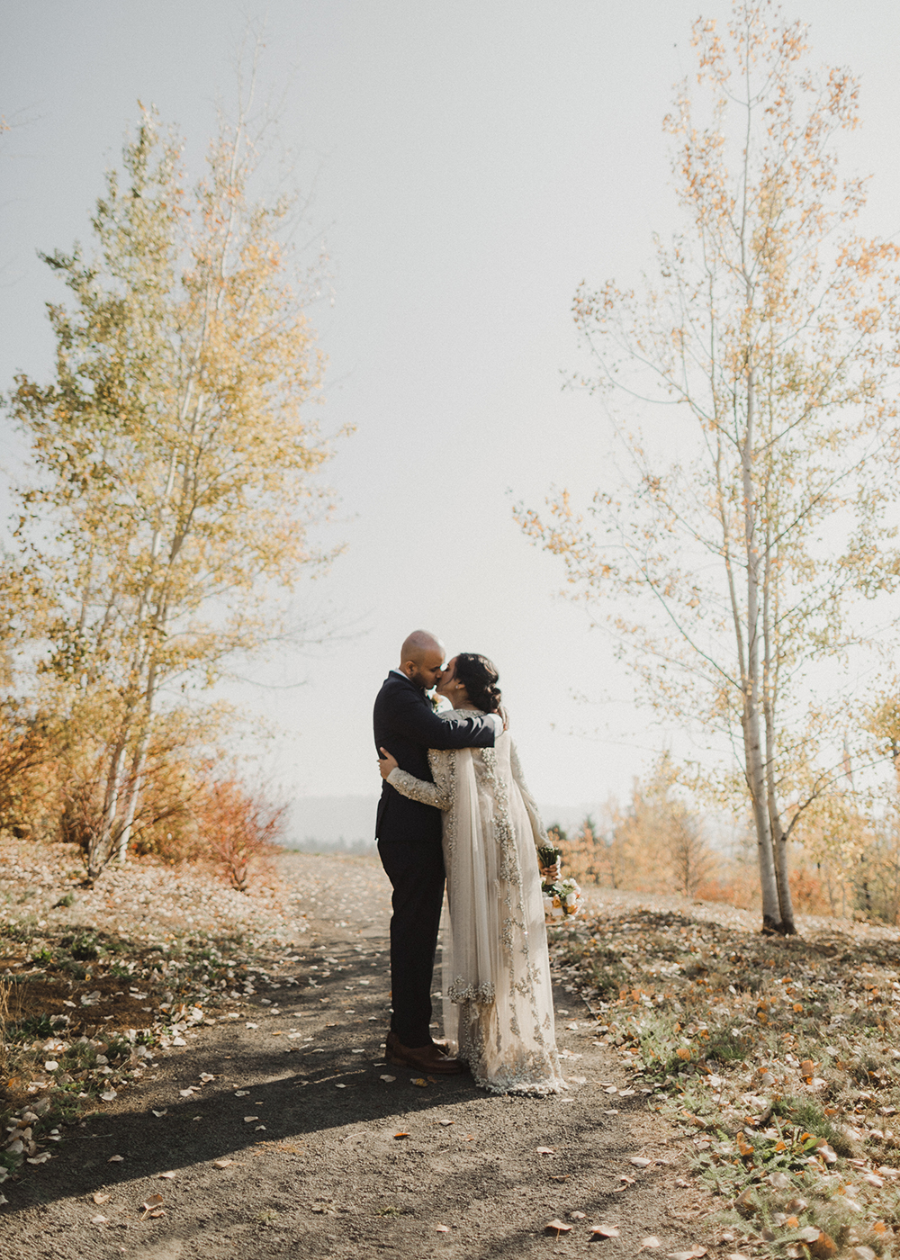 Fall with bride and groom kissing