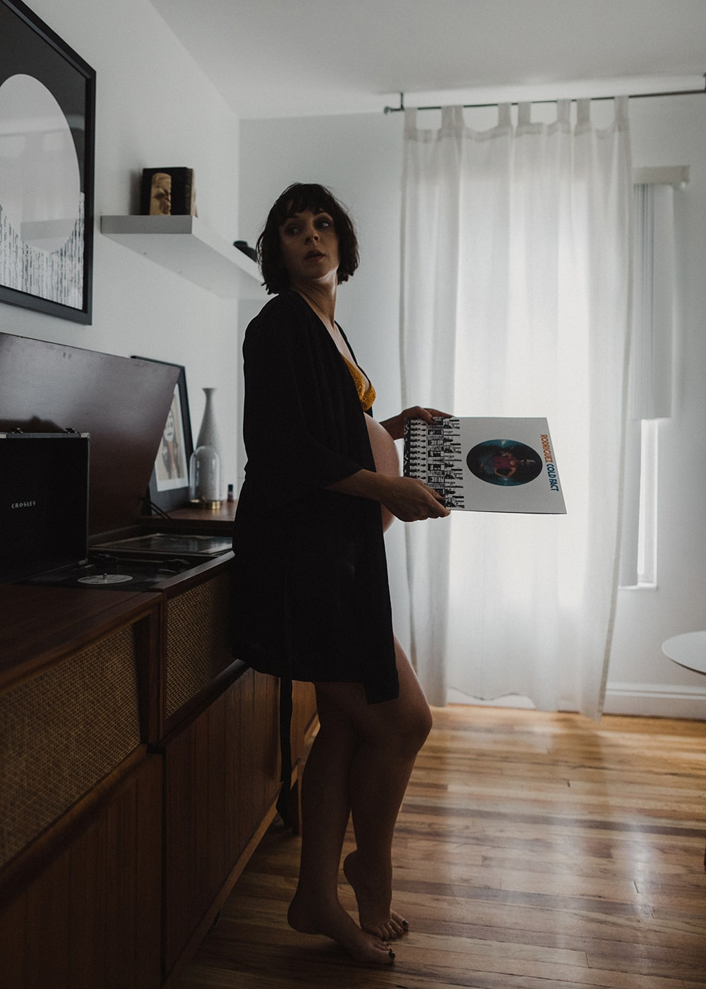 woman looking at record and relaxing