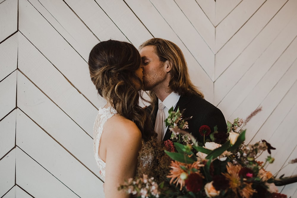couple kissing for first time husband sees her