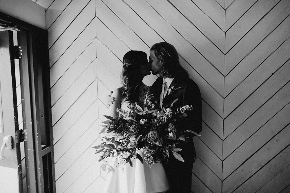 bride and groom cuddling inside door at union pine