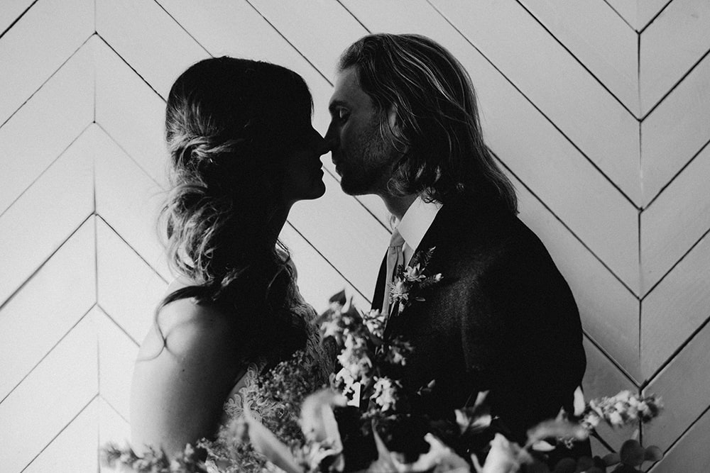 couple touching noses in black and white