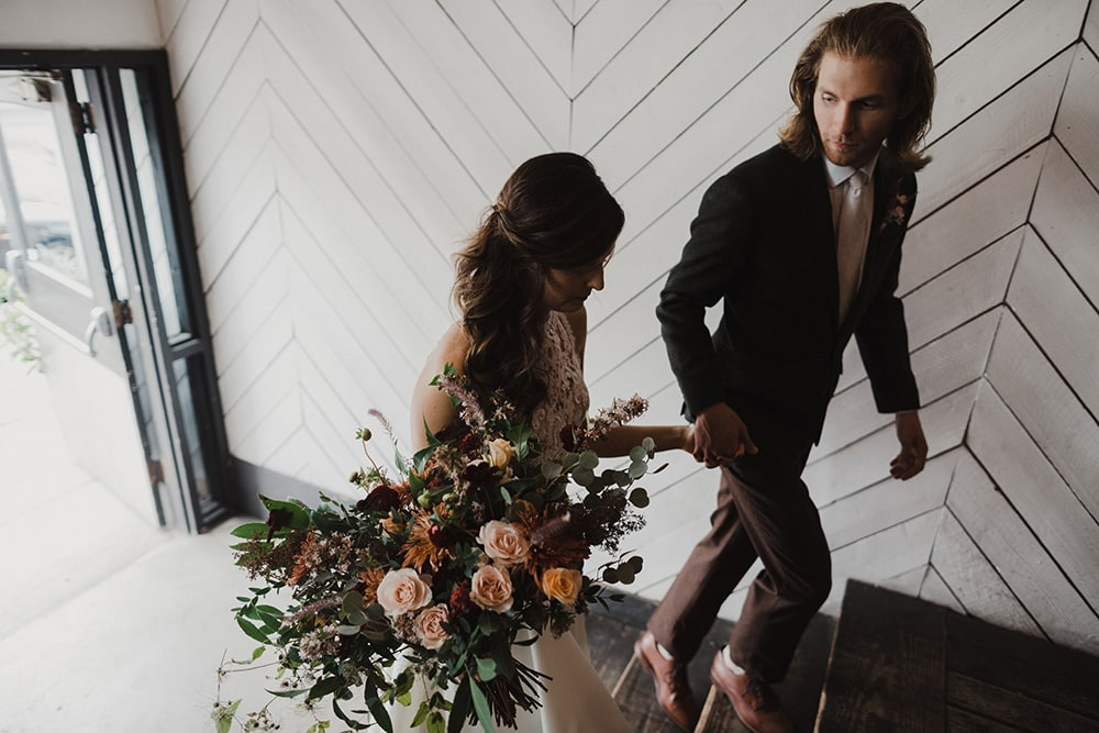 Bride and groom walking up stairs at Union Pine