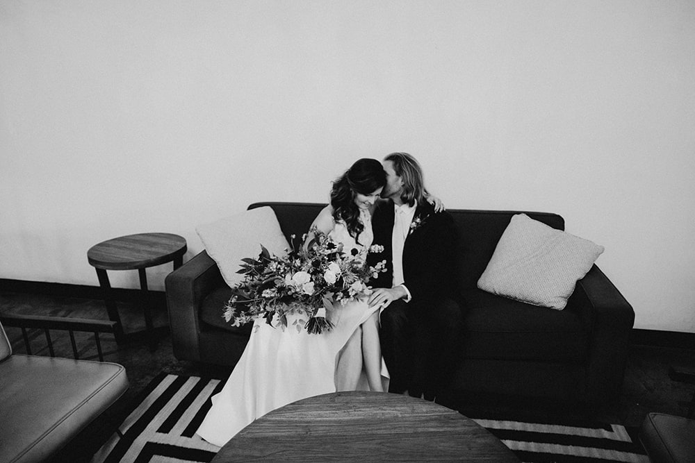 bride and groom hanging out on couches at union pine