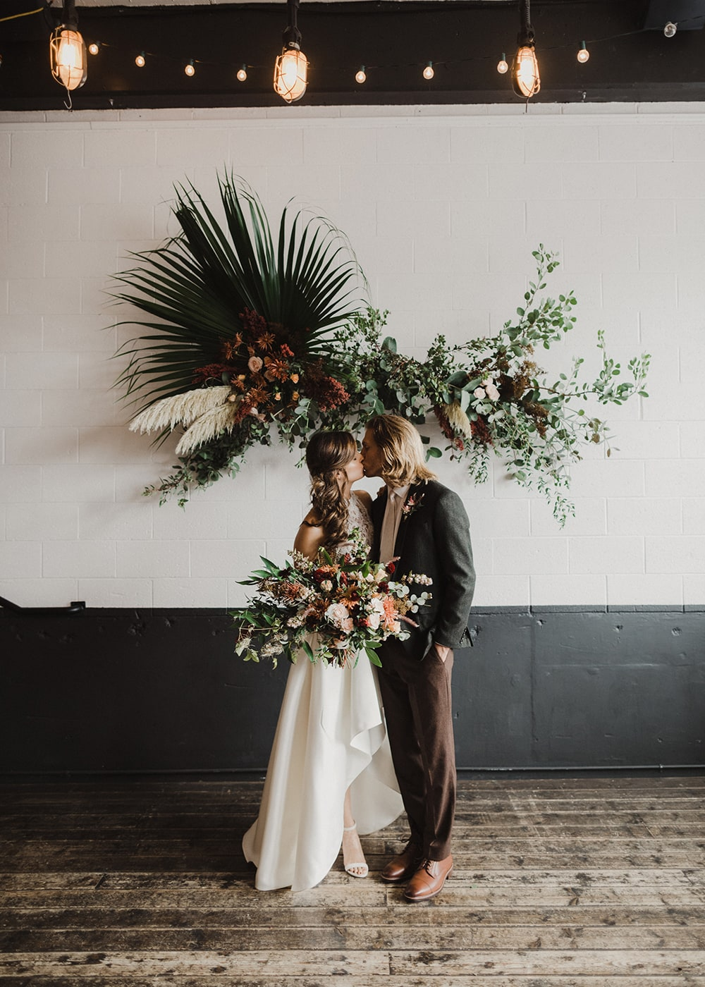 ceremony installation with couple in front kissing