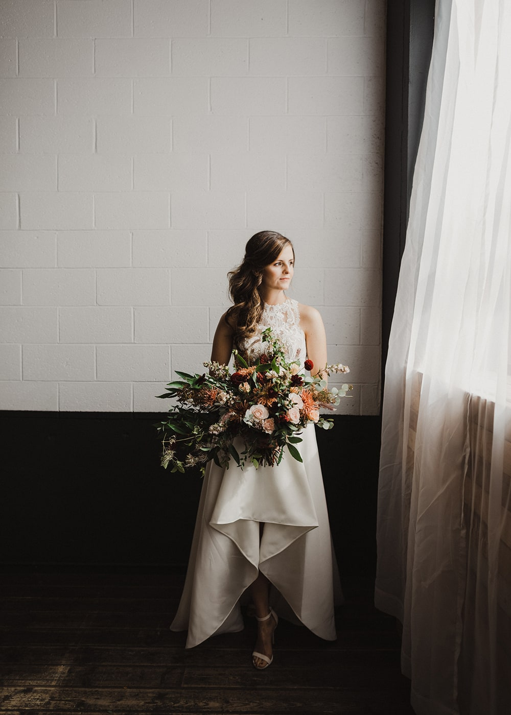 bride staring out window with relaxed expression