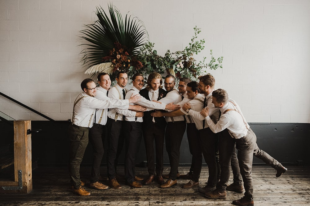 groomsmen hugging and laughing