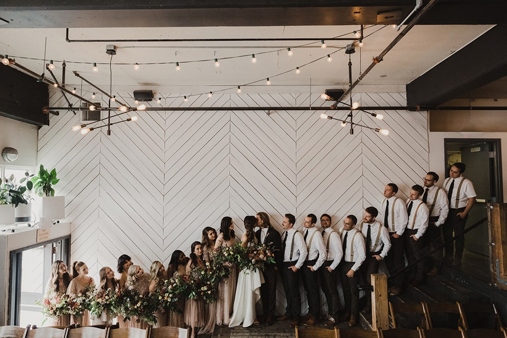 Bridesmaids and groomsmen standing on stairs