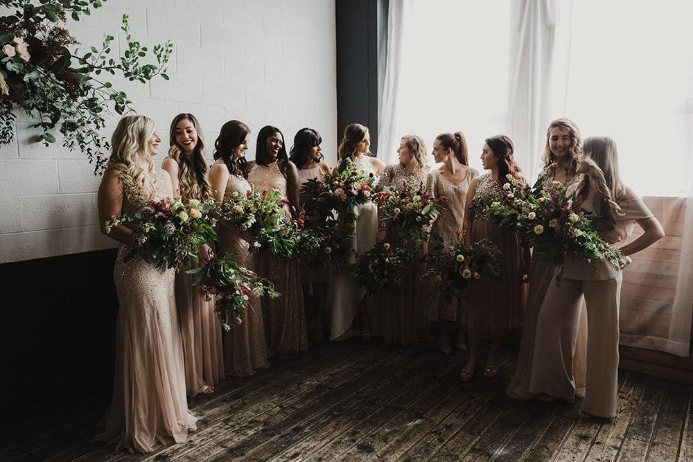 bridesmaids laughing and talking