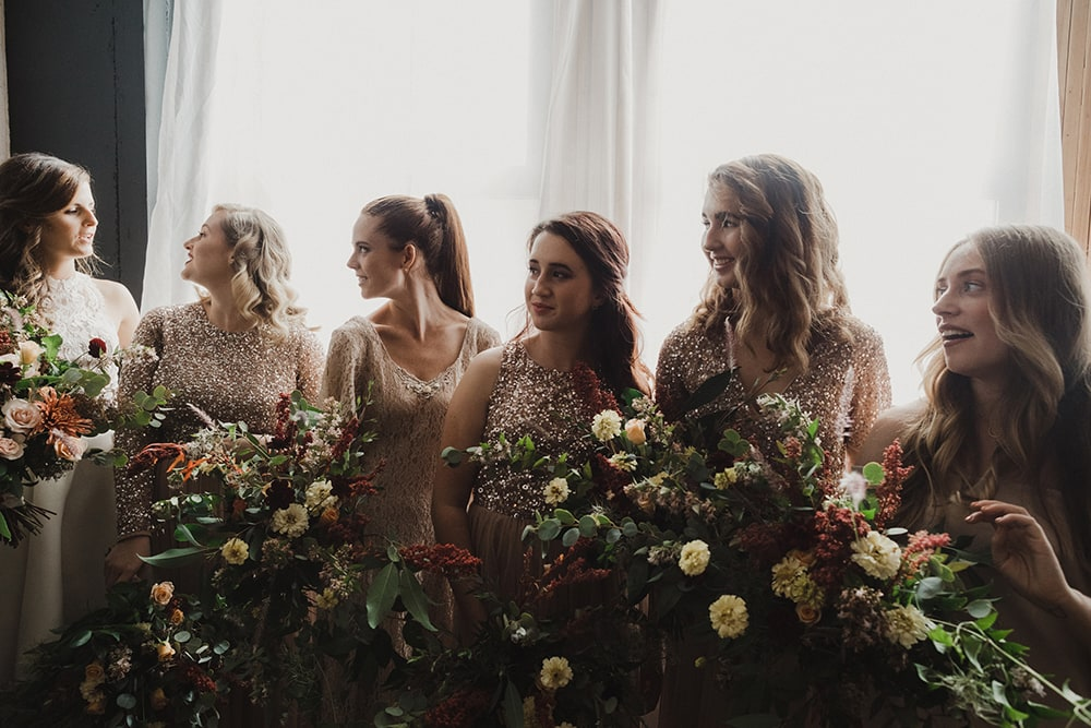 bridesmaids looking at bride with sweet faces