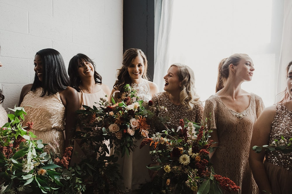 bridesmaids looking at each other