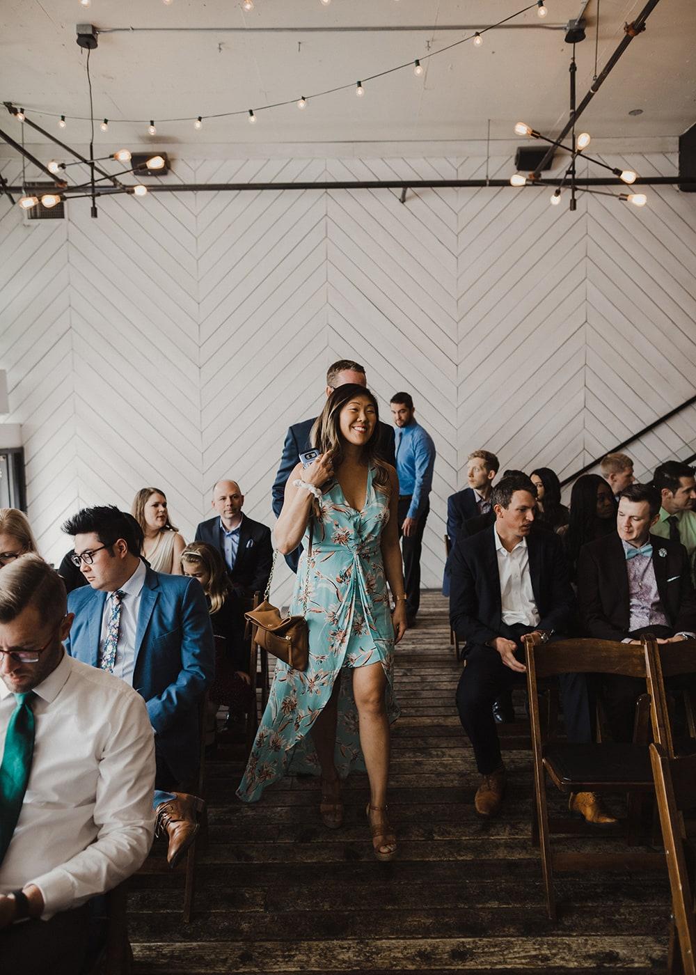 guests walking down isle at wedding