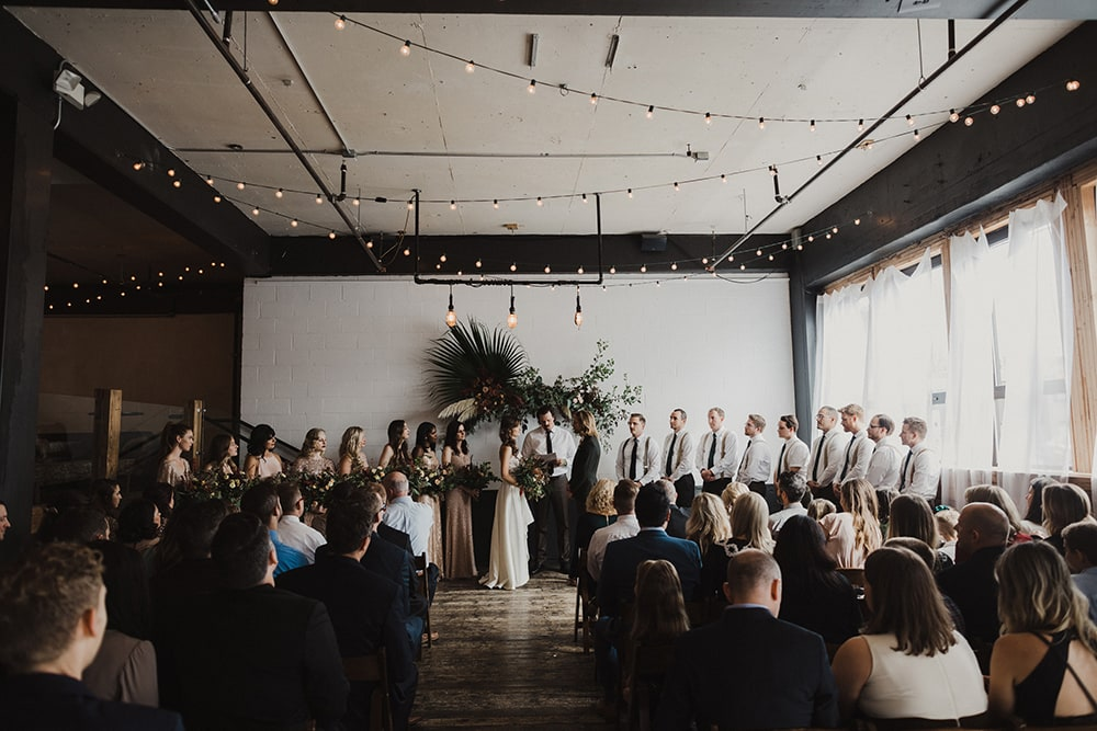 wedding ceremony taking place at union pine in portland oregon