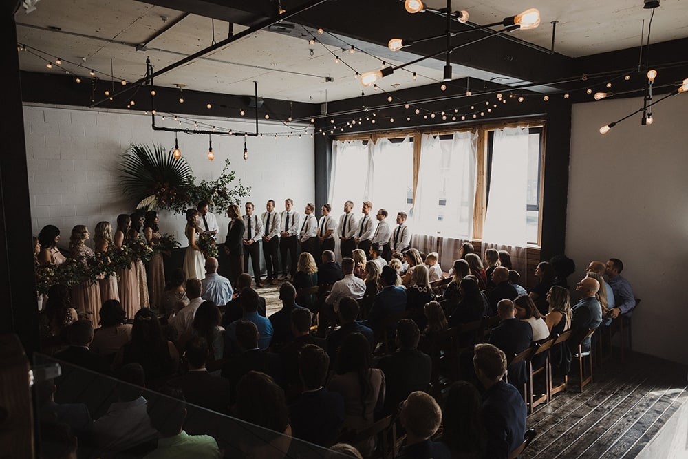 wedding ceremony with dim lighting and strong windows