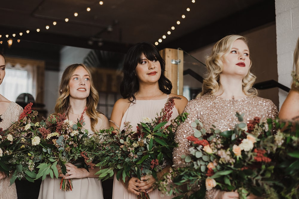 bridesmaids staring at bride during ceremony