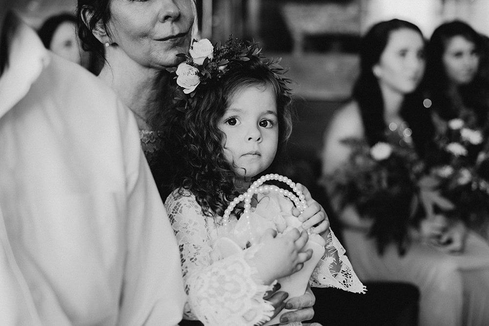 flower girl looking at photographer