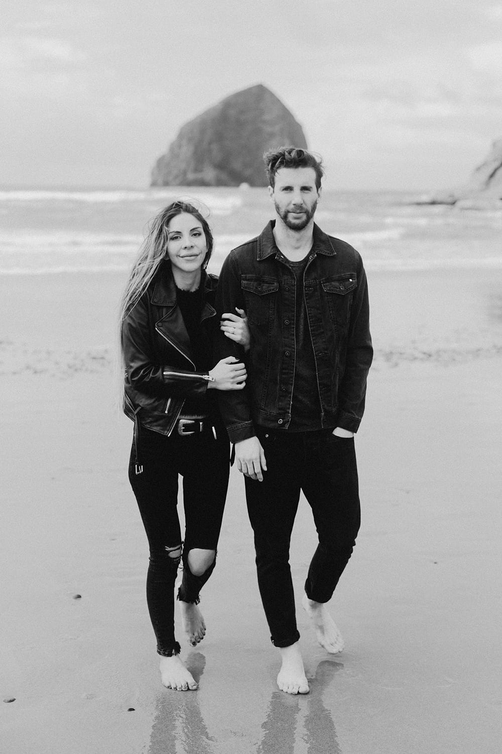couple walking toward photographer wearing all black