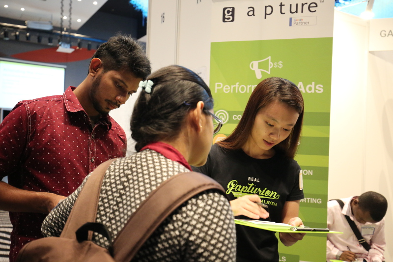 Gapturion intern Sook Yee checking the answers for the simple Digital Marketing test