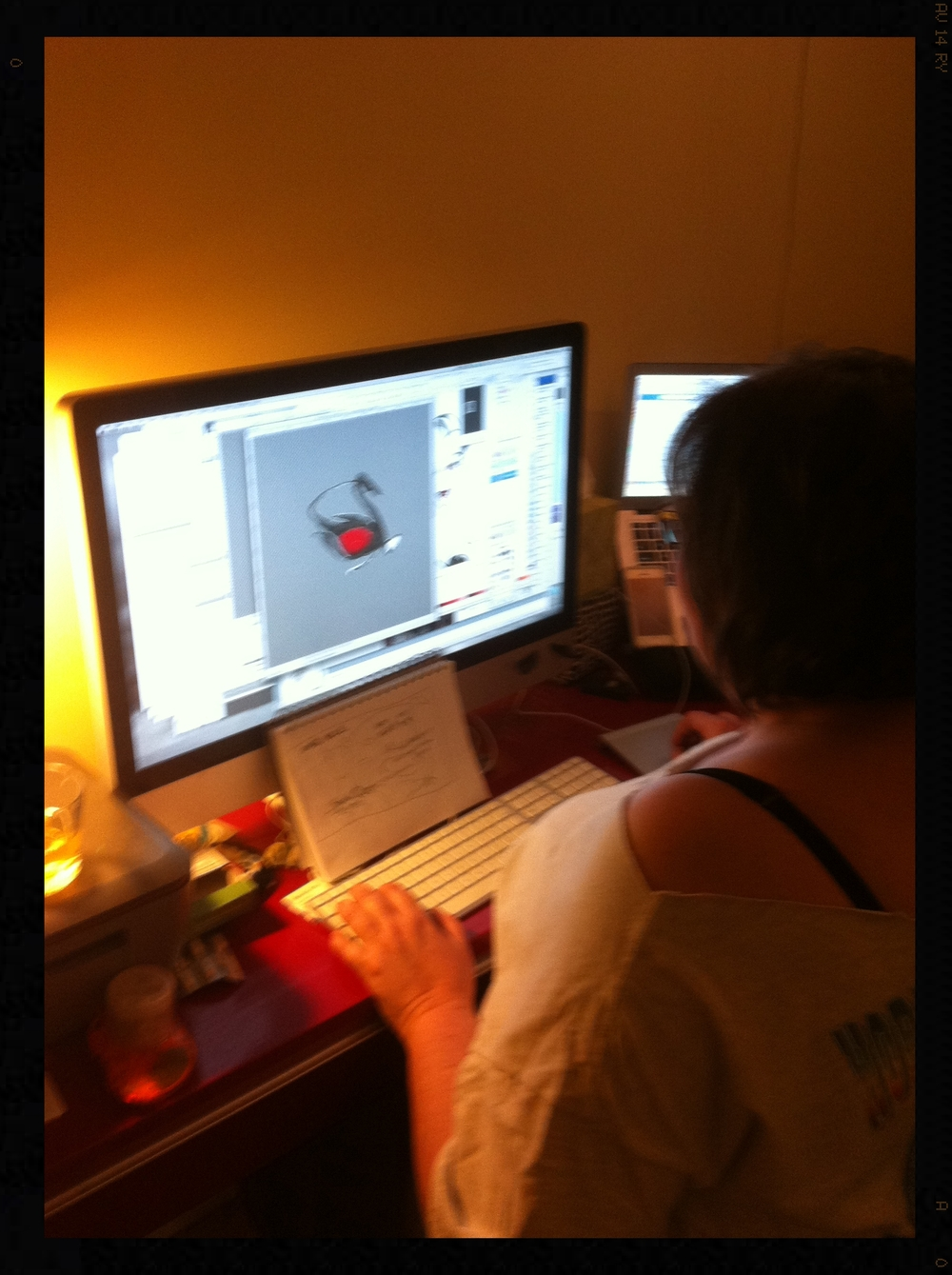 Meg Murray  finessing the  Swan Queen  promotional layouts.