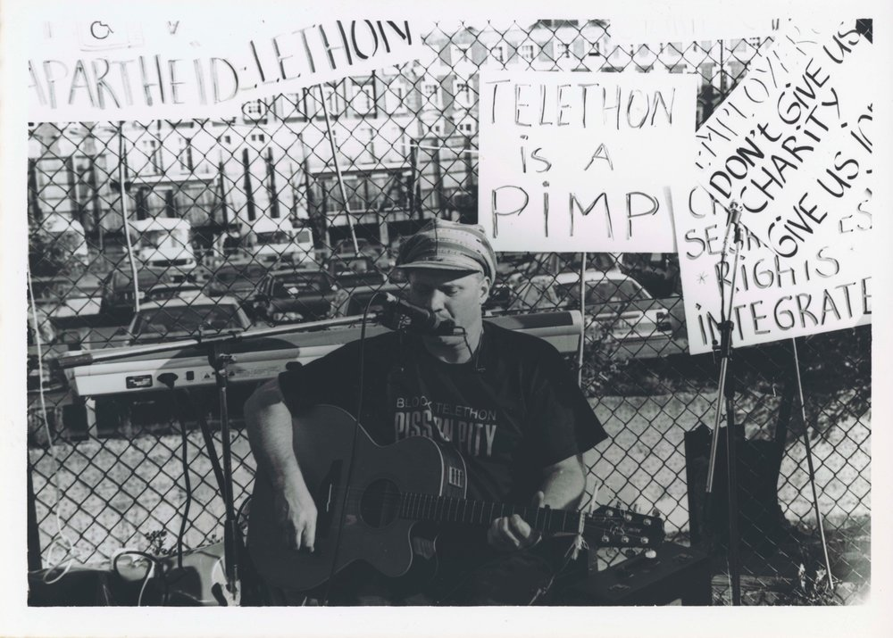 Photo of Johhny Crescendo performing at Block Telephon (1992), deposited by Elspeth Morrison: image produced by  THE-NDACA.ORG < http://the-ndaca.org/ >