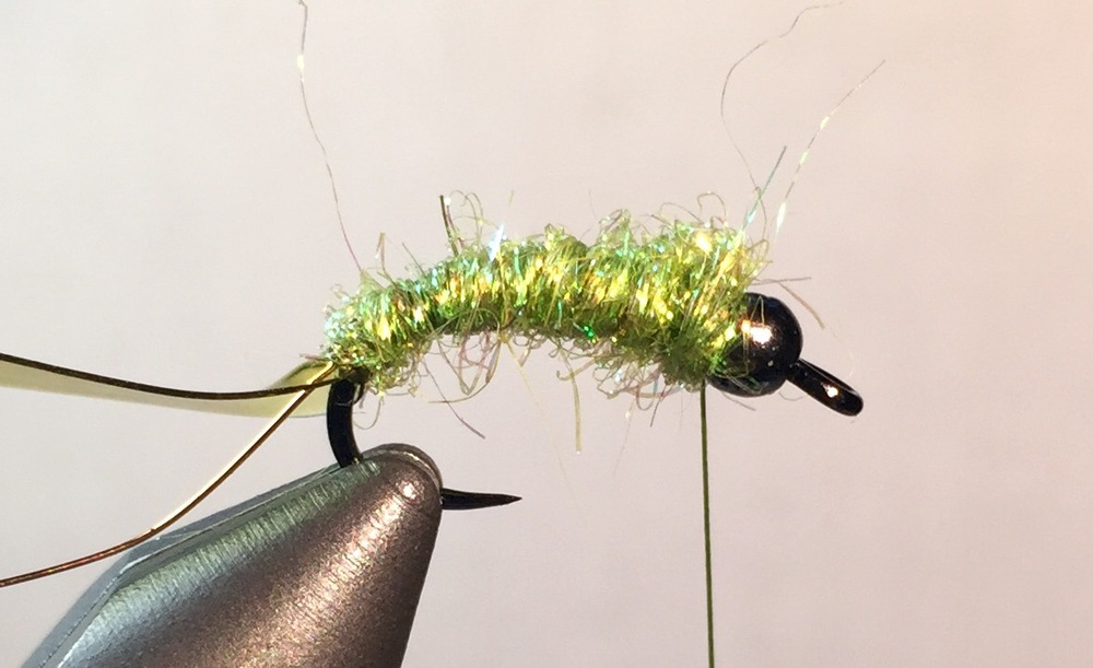 "Step 3:  Apply Orvis Hare' E Ice dubbing to the thread for approximately 4 to 5 inches (you can also use a dubbling loop in so inclined). Use your fingers to ""mat' the dubbing to the thread by briskly twisting. Wrap dubbing up to the bead. The dubbing should be bushy."