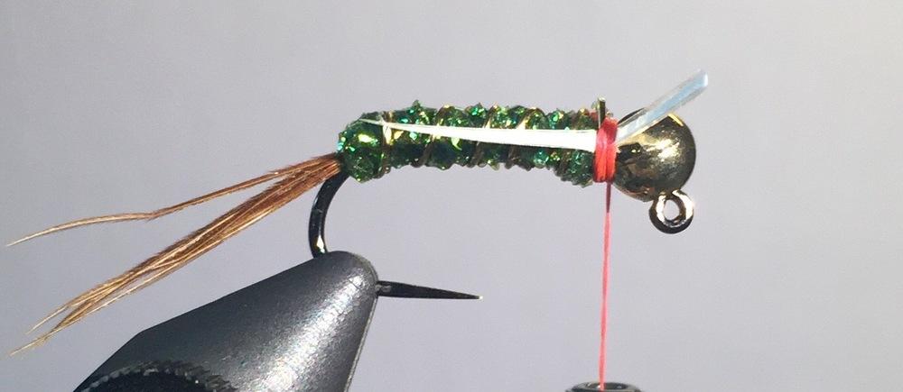 Step 6:  Tie in goose biot on each side of the hook.