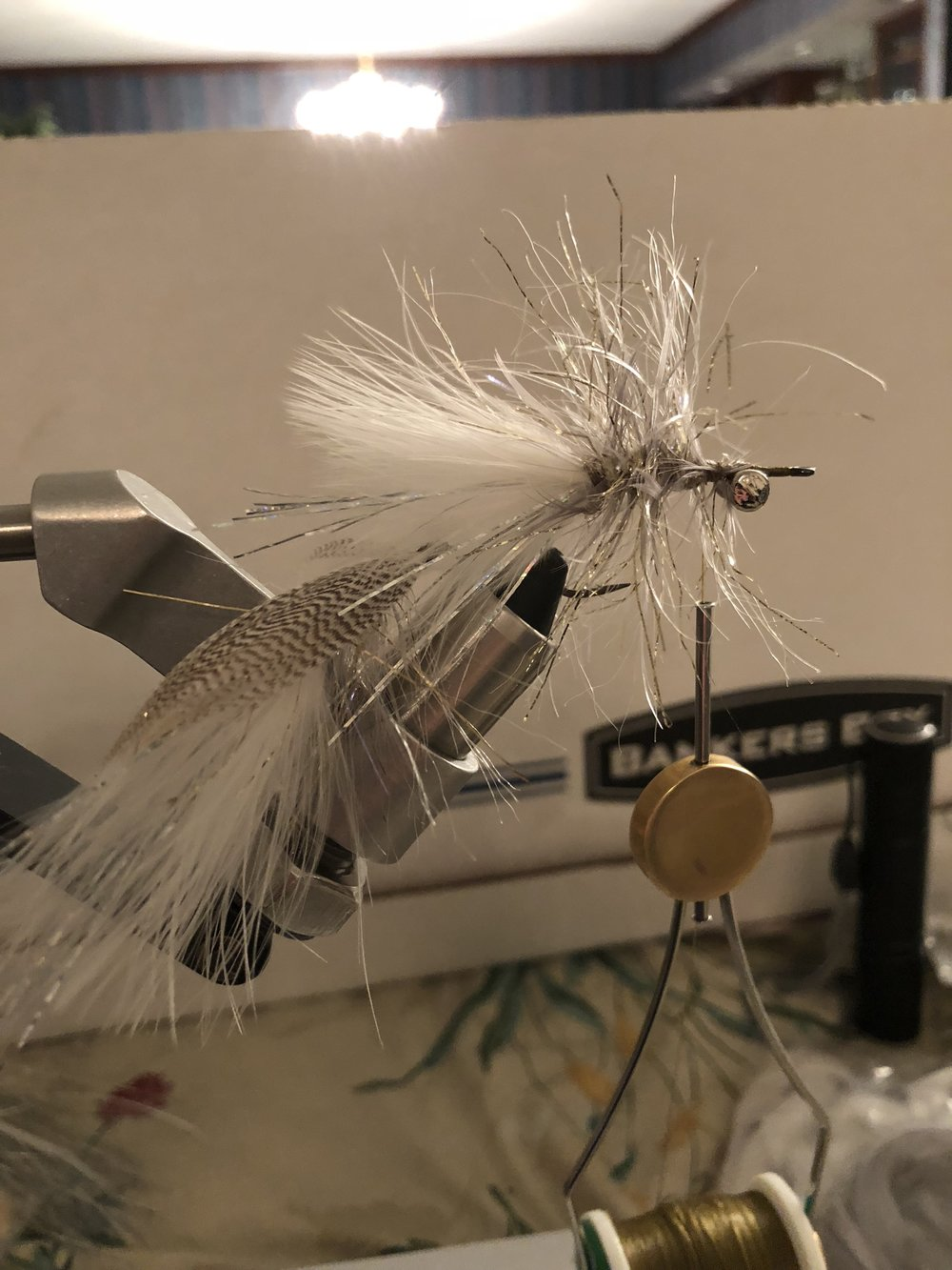 "Step 8:  Repeat the process of tying in polar chenille and this time schlappen rather than saddle hackle. Schlappen is more webby which creates more friction in the water to ""pump the brakes"" on the fly and give it dat action. It also has a bigger profile, which reinforces the baitfish taper.   Brush out trapped fibers to make it full!"