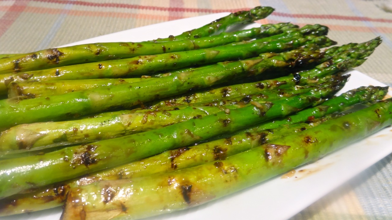 Grilled Asparagus with Ponzu Sauce   When you can go into a supermarket any day, any time of year and find practically everything you need or desire — like peaches in December or apples in June — it's easy to forget that there's such a thing as seasonal food. Yes, there are a few foods that still invite yearning, as you wait for them to be ready at a precise time. You can't force shad to spawn whenever you want them to, so shad lovers like me have to wait to buy the fish around May or June. And I have yet to see a pumpkin for sale in July. But even for the stuff you can buy whenever, there is an actual season where it is available locally. And that seasonal, local food is infinitely better. A tasty break from the transported foods from afar. Locally grown asparagus is just about beginning its season in many parts of the U.S. So if you like asparagus, now is the time to buy and savor it. Local, seasonal asparagus is like no other. The spears are more tender and delicate tasting than the others.   Also, it's Earth Day. If it's sunny out where you are and you have a grill, celebrate the call for eating local products when you can by grilling a bunch of asparagus. Or use a grill pan or an oven broiler. No matter. Here's a recipe for Grilled Asparagus with Ponzu Sauce. It's an easy recipe and you can skip the Ponzu Sauce if you like, because plain old grilled asparagus is fine too. You can save leftover Ponzu Sauce in the fridge for a few weeks.   Grilled Asparagus with Ponzu Sauce 6 tablespoons Ponzu Sauce 2 pounds asparagus 2 tablespoons olive oil salt to taste   Ponzu Sauce  1/2 cup orange juice 1/4 cup lemon juice 1/4 cup lime juice 1/2 cup soy sauce 1/4 cup rice vinegar 1 tablespoon fresh ginger, grated 1 serrano chile, deseeded and chopped 2 scallions, finely chopped 1/4 teaspoon ground coriander   Make the Ponzu Sauce and let it rest for at least one hour. Preheat an outdoor grill or indoor grill pan (or oven broiler). Wash and trim the asparagus and dry the stalks on paper towels. Rub the olive oil over the asparagus. Grill the asparagus for 6-8 minutes, or until they are tender, turning them occasionally and brushing with the Ponzu Sauce. Makes 4-6 servings   To make the Ponzu Sauce: place the orange juice, lemon juice, lime juice, soy sauce and rice vinegar in a bowl. Add the ginger, chili pepper, scallions and coriander. Mix well and let rest for one hour or more before using. Makes about 1-3/4 cups