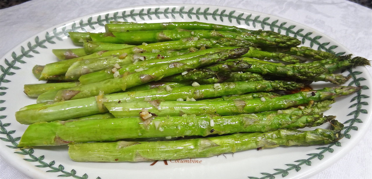 When in need of a quick, festive side dish, think asparagus. They're elegant looking and there's very little you have to do to them. Only the real fat ones need peeling. Wash them off, cut off the fibrous, purplish-white ends and cook them. Either steam, poach or roast them. It takes just minutes, depending on thickness. Here's one of my favorites, to be served tonight with my pre-fast dinner. Lemony Roasted Asparagus 1 pound mediun thick asparagus 1 tablespoon olive oil 1 clove garlic, finely chopped 1 teaspoon grated fresh lemon peel salt and freshly ground black pepper 2 tablespoons lemon juice Preheat the oven to 450 degrees. Trim the ends from the asparagus, wash and dry them and place on a cookie sheet. Drizzle with the olive oil and scatter the garlic and lemon peel on top. Sprinkle with salt and pepper, then roll the asparagus to coat them on all sides with the other ingredients. Roast for 10-15 minutes, depending on thickness, or until tender. Sprinkle with the lemon juice. Serve hot or at room temperature. Makes 4-6 servings